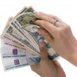 Paper money in hands — Stock Photo