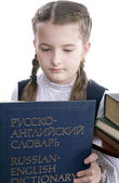 Girl and Russian-English dictionary — Stock Photo