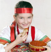 Russian girl with caviar and a pancake in a hand. — Stock Photo