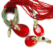 Necklace and earrings with red stone and snake. — Stock Photo