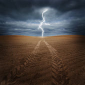 Storm on the dry field — Foto Stock