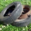 Stock Photo: Discarded car tyres