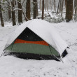 Tent in a spring snow — Stock Photo