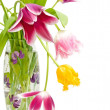 Bouquet of tulips of different colors in the vase — Stock Photo