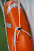 Orange ring-buoy on a boat — Stock Photo