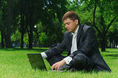 Businessman in the park — Stock Photo