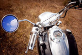 Reflection of blue sky and clouds in the rearview mirror motorcy — Stock Photo