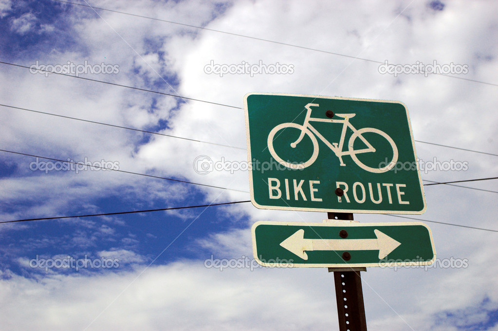 Bicycle route sign with blue sky and white clouds in background — Stock Photo #5339090