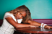 African American girl at a bar table — Stock Photo