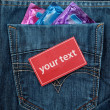 Three condom in jeans backpocket — Stock Photo