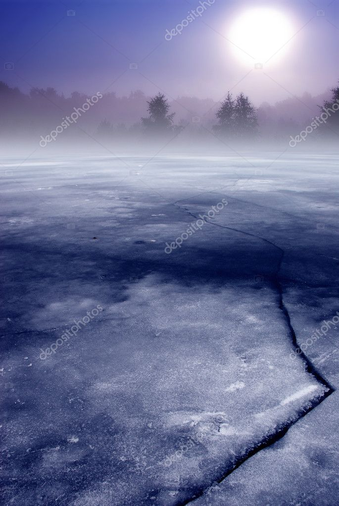 Frozen lake and forest in fog image — Stock Photo #5301860
