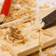 Stock Photo: Chisel, sawdust and wood plaque