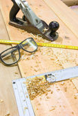 Safety glasses and work tools — Stock Photo