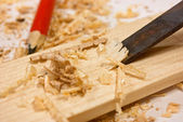 Chisel, sawdust and wood plaque — Stock Photo