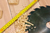 Circular saw with measure tape — Stock Photo