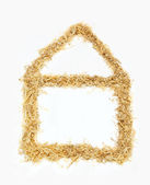 Eco house shape from wood chips — Stock Photo