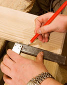 Carpenter hand with square and pencil — Stock Photo