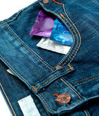 Condom in jeans — Stock Photo