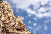 Big rock under blue clouded sky — Stock Photo