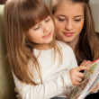 Two Sisters Reading - Stock Photo