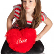 Girl Sitting With Heart Shaped Pillow — Stock Photo