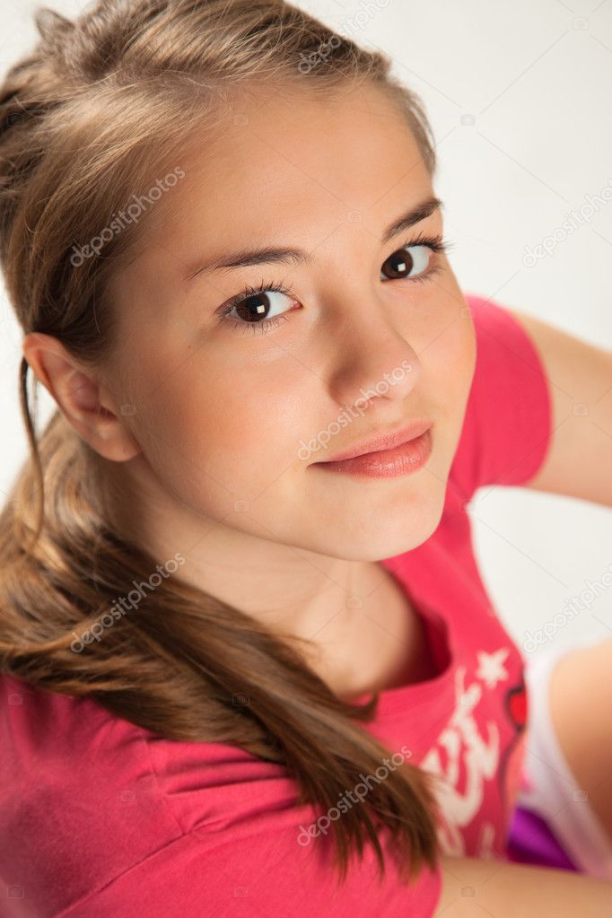 Beautiful Girl in pink Sitting looking up.  Stock Photo #5363730
