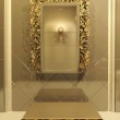 Royal mirror with gold frame in luxury interior — Stock Photo #5368764