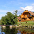 Beautiful wooden house near the river — Stock Photo
