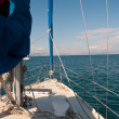thumbnail of White yacht sailing on calm sea