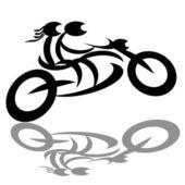 Pár motorkářů na motocyklu