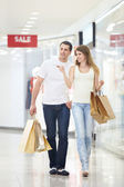 Attractive couple in shop