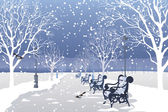 Snow falling in a city park