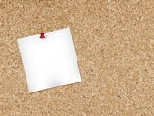 Note pad pinned to a cork bulletin boardVector illustration