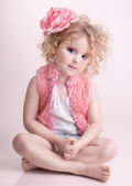 Little girl in fashion clothes