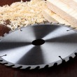 thumbnail of Circ saw blades, planks and shavings on dark background