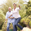thumbnail of Couple Jumping On Trampoline In Garden