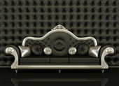 Classic leather sofa with a silver frame on black background