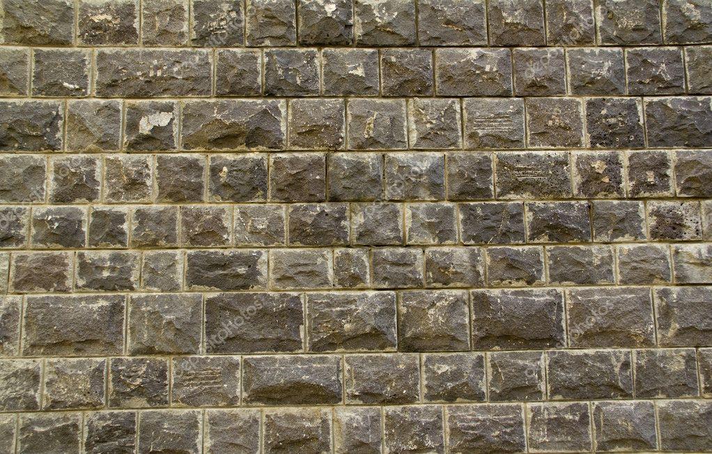 Black Basalt Stone Wall : Black basalt stone wall background — stock photo k