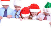 Fotografie Christmas children with a banner