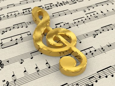 Golden treble clef on score paper