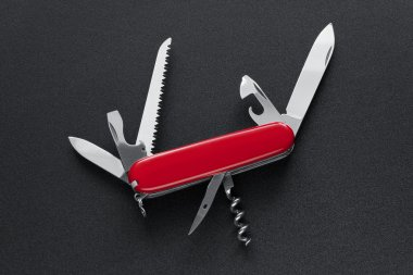 Swiss army knife isolated on black