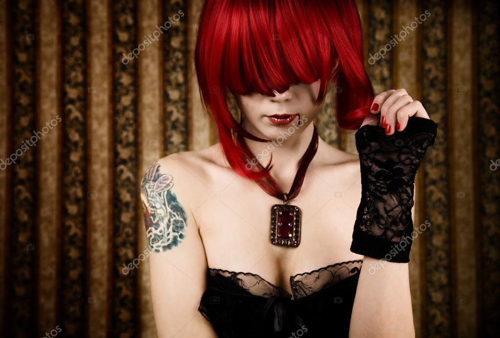 Redhead vampire with drop of blood