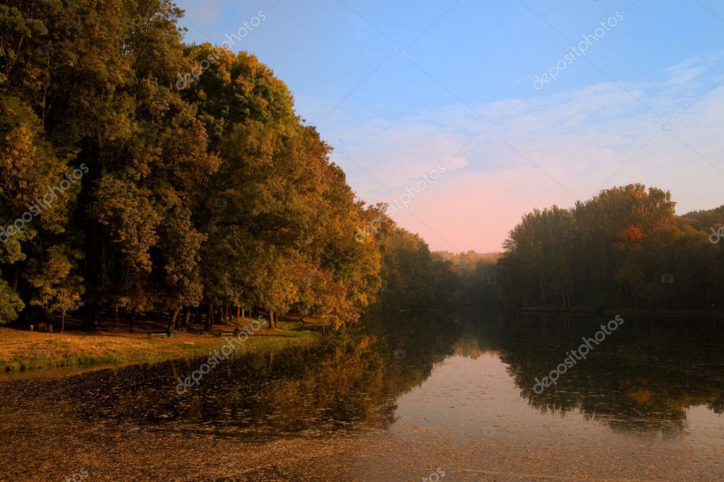 Autumn landscape with lake and fog