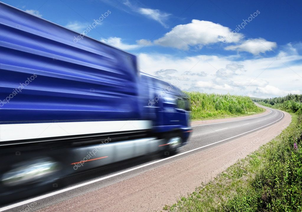 Truck speeding on country highway, motion blur