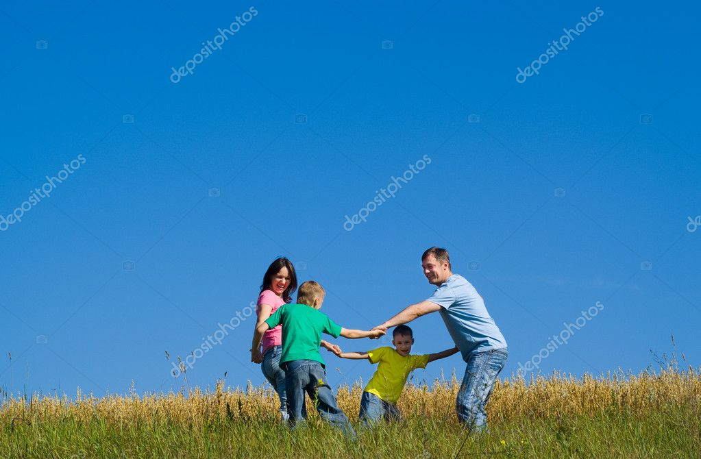 Happy cheerful dancing family