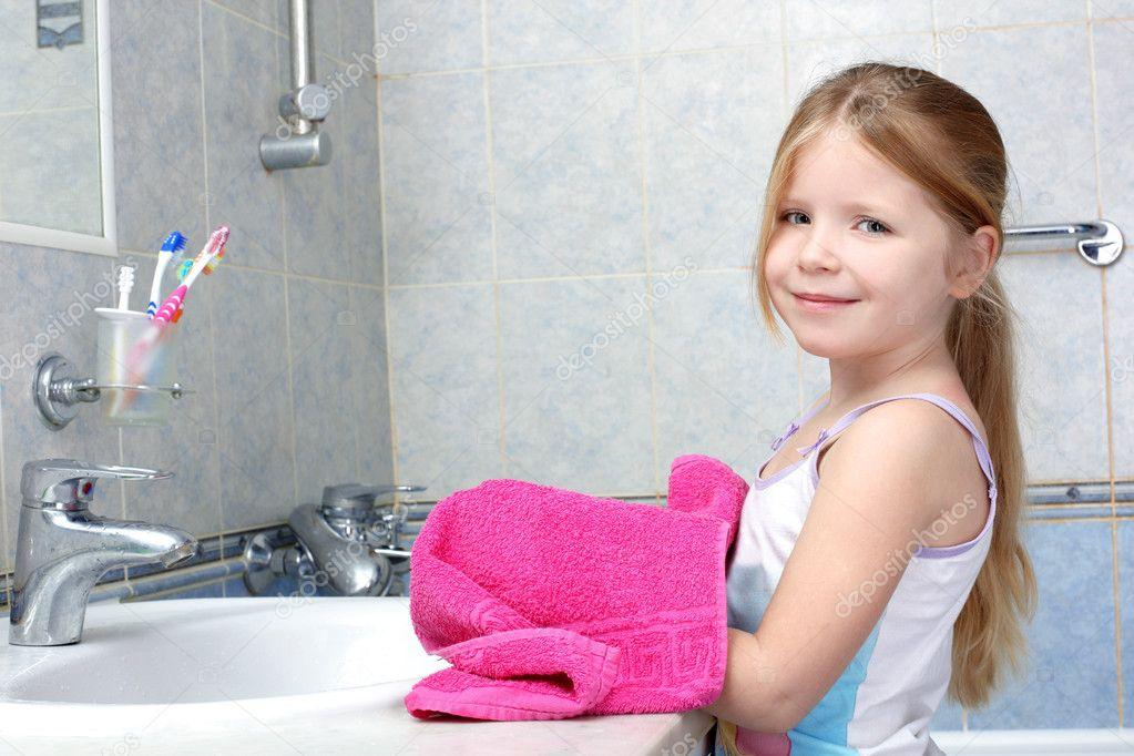 Little girl taken towel after washing in bathroom   Stock Photo  4491436. Little girl taken towel after washing in bathroom   Stock Photo