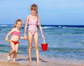 Photo Children playing on beach.