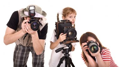 Photographer with his family taking picture.