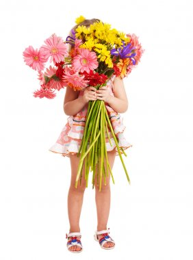 Child holding flowers.