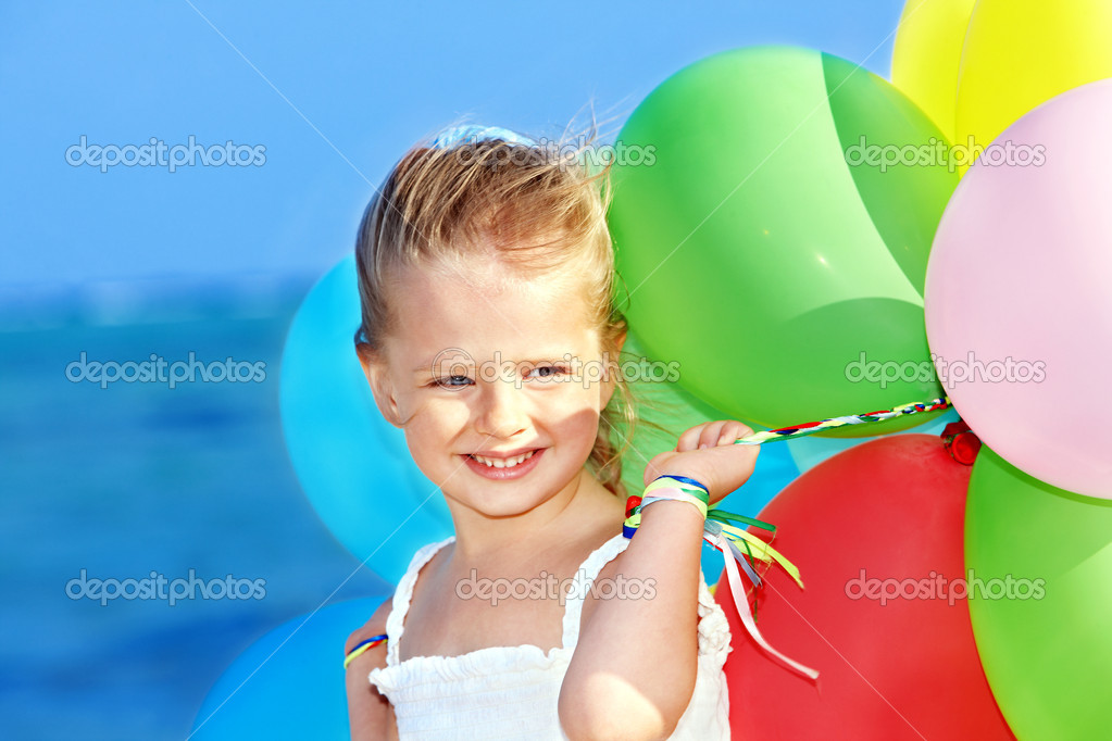Child playing with balloons .